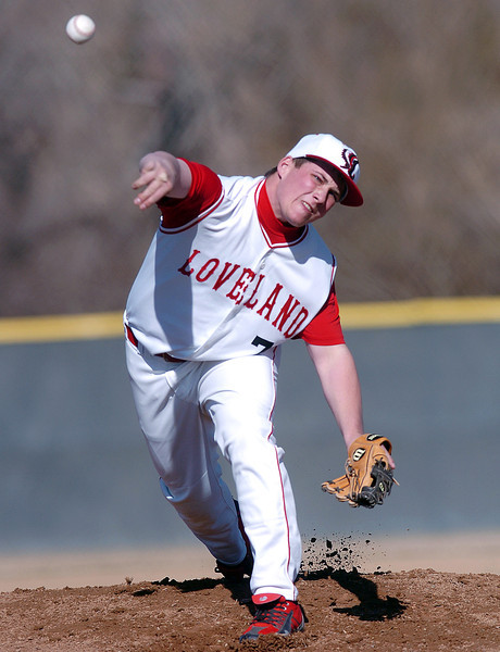 Loveland High School senior Drew Posegate throws a pitch in the top of the first inning of a game against Thompson Valley on Tuesday, March 16, 2010 at Swift Field. Loveland won, 14-4, in the fifth inning.