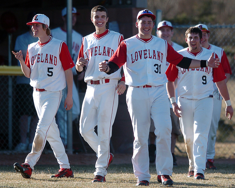 Loveland High School baseball players are all smiles as they emerge from the dugout after beating Thompson Valley on Tuesday, March 16, 2010 at Swift Field. From left are Jered Ratschokowsky, Darius Coldiron, Darryl Baca and Matt Walkowicz. Loveland won, 14-4, in the fifth inning.