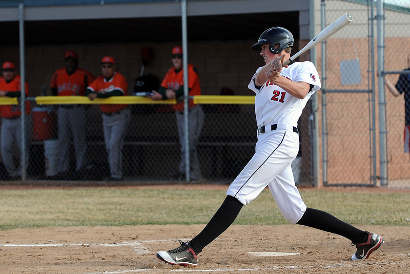 Loveland High School junior Alec Hansen follows through at the plate after connecting with the ball in the bottom of the second inning of a game against Adams City on Friday, March 16, 2012 at Swift Field.