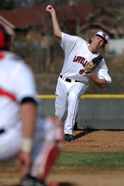 Loveland High School senior Barry Hall throws a pitch in the top of the first inning of a game against Adams City on Friday, March 16, 2012 at Swift Field.