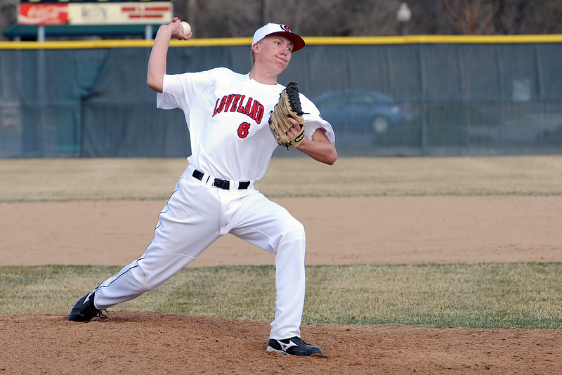Loveland High School senior Barry Hall throws a pitch in the top of the third inning of a game against Adams City on Friday, March 16, 2012 at Swift Field.