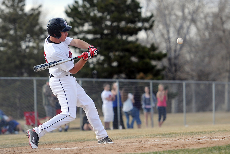 Loveland High School junior Jay Larson eyes a pitch during an at bat in the bottom of the third inning of a game against Adams City on Friday, March 16, 2012 at Swift Field.
