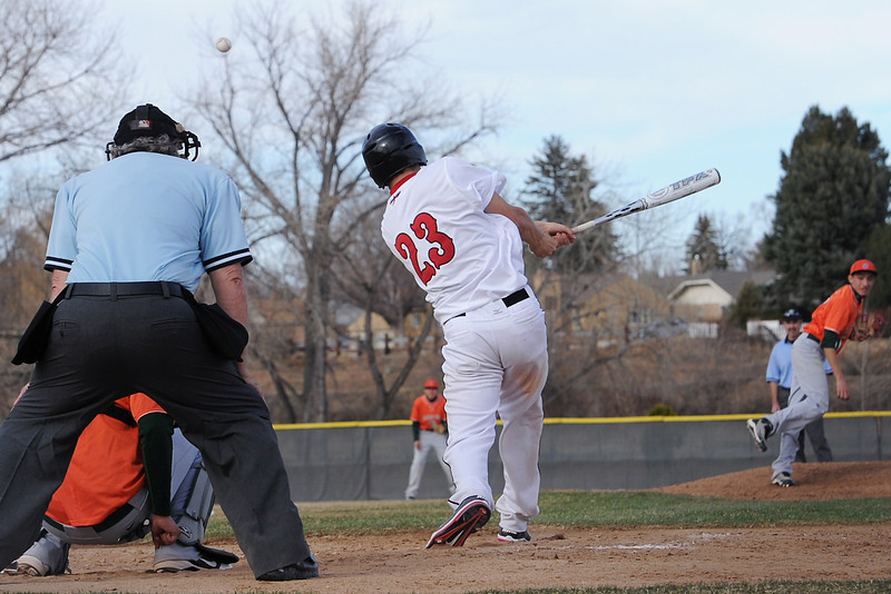 Loveland High School sophomore Ryan McCloughan (23) smacks a triple in the bottom of the third inning of a game against Adams City on Friday, March 16, 2012 at Swift Field.