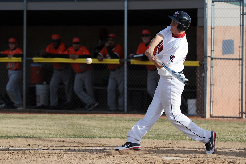 Loveland High School's Ryan McCloughan during an at bat in the bottom of the fourth inning of a game against Adams City on Friday, March 16, 2012 at Swift Field.