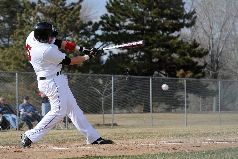 Loveland High School senior Matt Walkowicz hits a single in the bottom of the first inning of a game against Adams City on Friday, March 16, 2012 at Swift Field.