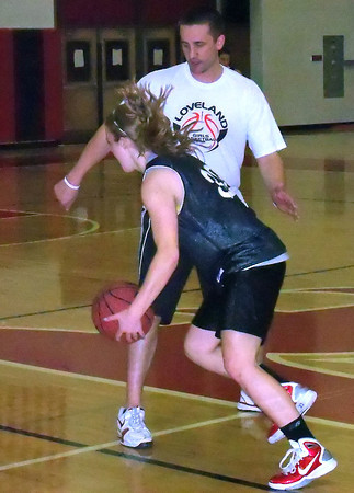 Loveland High School's Addie Coldiron dribbles around assistant coach Jesse Laner during Thursday's practice. Ove the holiday break, area athletes have continued to practice in anticipation of school starting next week. The Indians will host Rocky Mountain on Tuesday to open Front Range League play.