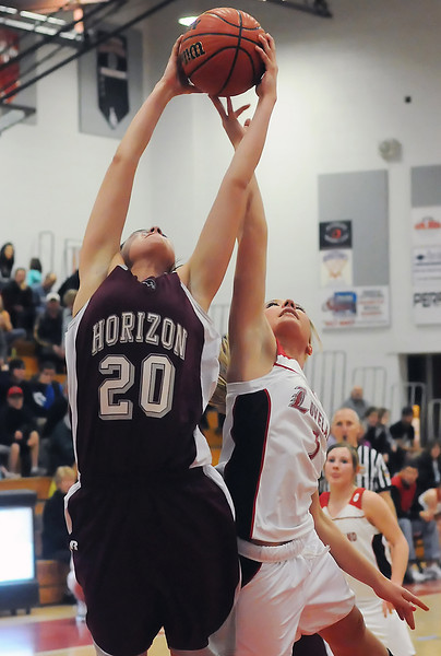 Loveland High School's Betsy Rodgers, right, goes up for a rebound during a game against Horizon on Tuesday, Feb. 9, 2010 at LHS.