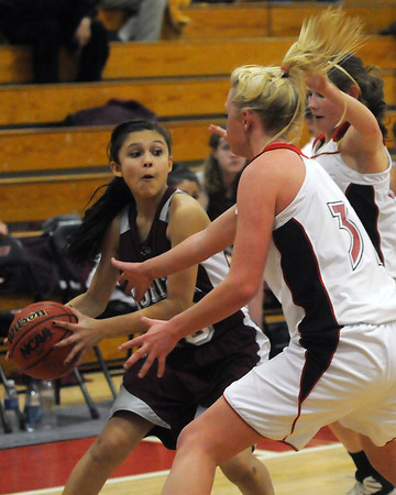 Loveland High School teammates Shelby Jones, front, and Colissa Bakovich apply backcourt pressure to Horizon's Gabby Jimenez in the second quarter of their game on Tuesday, Feb. 9, 2010 at LHS.
