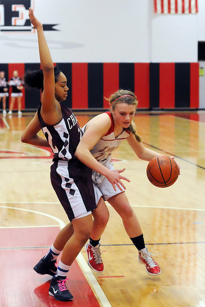 Loveland High School sophomore Adeline Coldiron, right, drives to the basket around Cherokee Trail's Qiana Barfield in the first quarter of their game Tuesday, Feb. 22, 2011 at LHS. The Indians won, 63-28.