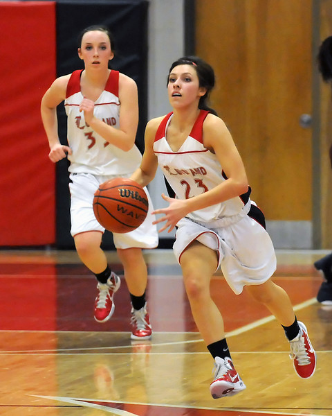 Loveland High School sophomore Michelle Petrie (23) dribbles the ball ahead of teammate Brooke Nyenhuis in the fourth quarter of their game against Cherokee Trail on Tuesday, Feb. 22, 2011 at LHS. The Indians won, 63-28.