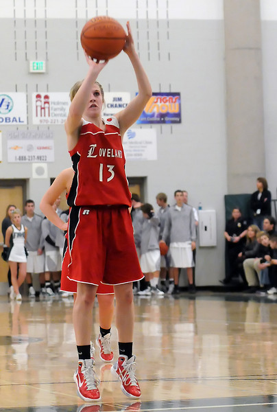 Loveland High School senior Stephanie Hutsell shoots a freethrow in the fourth quarter of a game against Fossil Ridge on Tuesday at FRHS. The Indians won, 53-50.