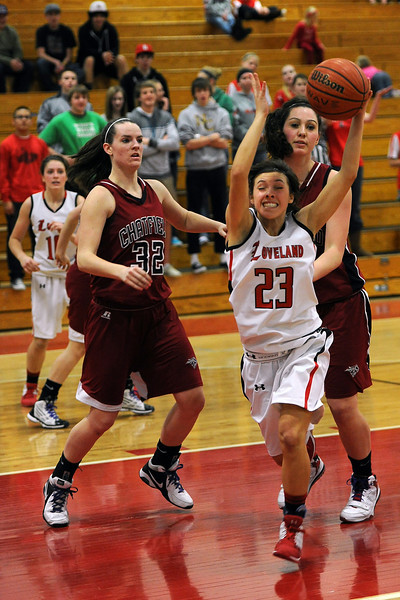 Loveland High School junior Michelle Petrie (23) grabs a rebound in the third quarter of a game against Chatfield on Wednesday, Feb. 22, 2012 at LHS.