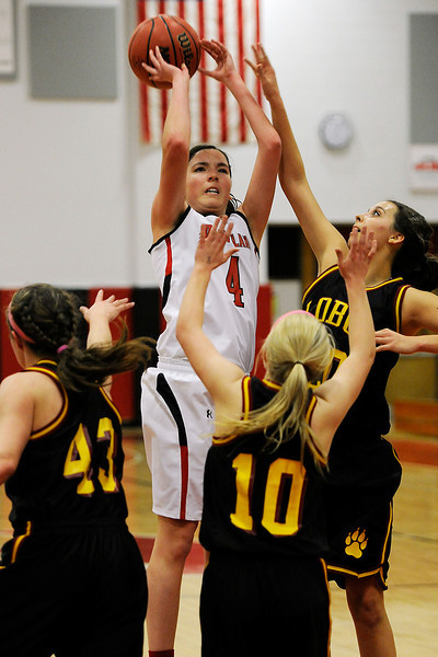 Loveland High School junior Lauren Spencer (4) shoots a jump shot during a game against Rocky Mountain on Thursday, Feb. 9, 2012 at LHS.