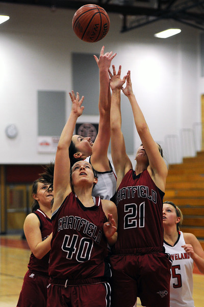 Chatfield High School's Ella Gray (40) and Madi Walker (21) go up for a rebound with Loveland's Lauren Spencer while Laclyn Lean, back left, and Bradey King, right, look on in the second quarter of their game on Wednesday, Feb. 22, 2012 at LHS.