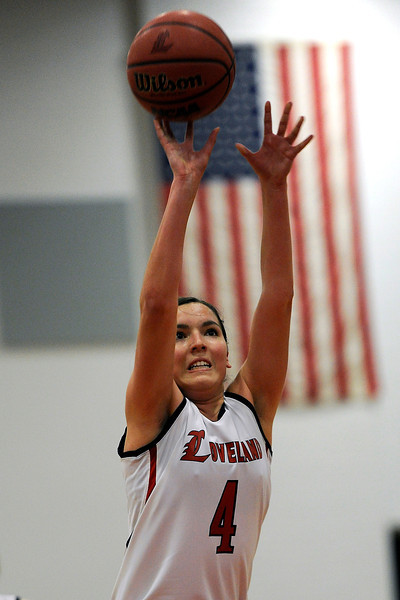Loveland High School junior Lauren Spencer shoots a free throw during a game against Rocky Mountain on Thursday, Feb. 9, 2012 at LHS.