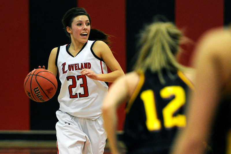 Loveland High School junior Michelle Petrie, left, brings the ball up against Rocky Mountain's McKenna Dando in the second quarter of their game Thursday, Feb. 9, 2012 at LHS.