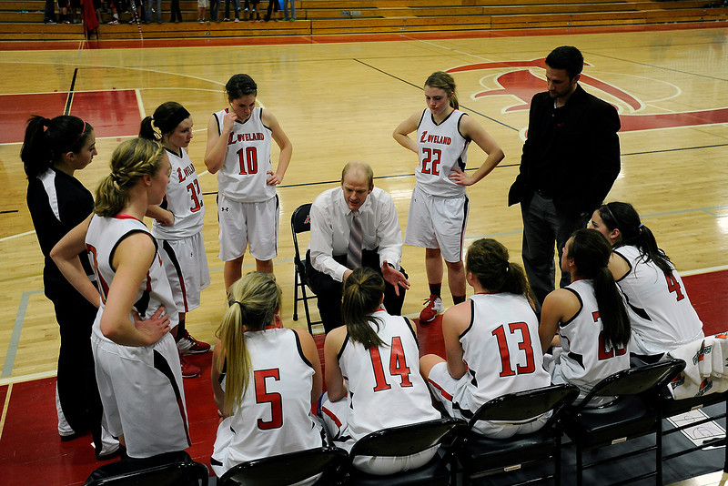 Loveland High School girls head basketball coach Chris Michael, middle, talks to his players during a time-out of a game against Rocky Mountain on Thursday, Feb. 9, 2012 at LHS.
