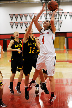 Loveland High School junior Lauren Spencer, right, takes the ball to the basket during a game against Rocky Mountian on Thursday, Feb. 9, 2012 at LHS.