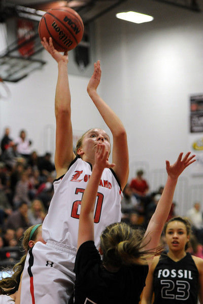 Loveland High School senior Karina Schlecht, top, puts up a shot over Fossil Ridge's Haley Murphy while Gabrielle Smith, right, looks on in second quarter of their game Tuesday, Feb. 14, 2012 at LHS.