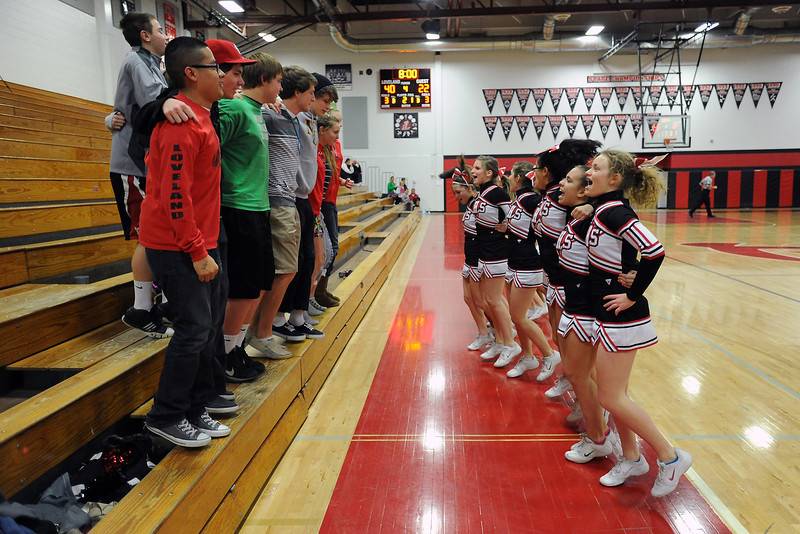 Loveland High School cheerleaders and students cheer on the girls basketball team inbetween the third and fourth quarters of a game against Chatfield on Wednesday, Feb. 22, 2012 at LHS.