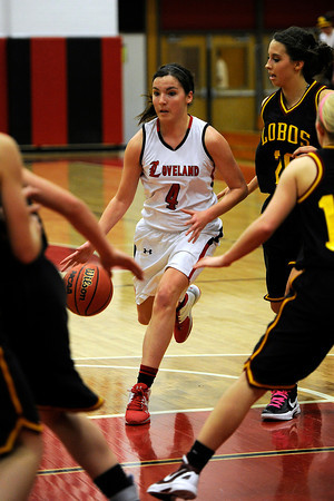 Loveland High School junior Lauren Spencer (4) drives to the basket during a game against Rocky Mountain on Thursday, Feb. 9, 2012 at LHS.