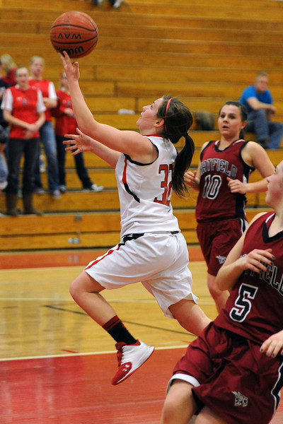 Loveland High School junior Colissa Bakovich, left, takes the ball to the basket in the third quarter of a game against Chatfield on Wednesday, Feb. 22, 2012 at LHS.