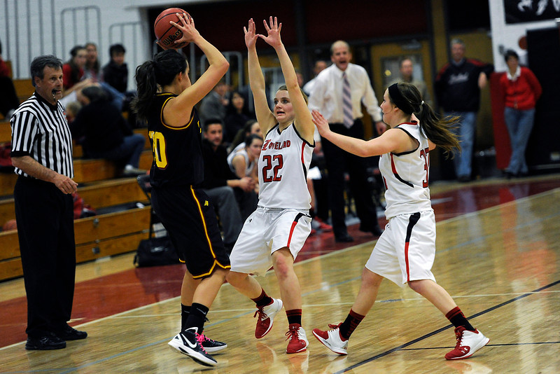 Loveland High School teammates Colissa Bakovich, right, and Addie Coldiron apply defensive pressure to Rocky Mountain's Anna Ernst in the first quarter of their game Thursday, Feb. 9, 2012 at LHS.