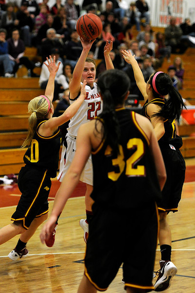 Loveland High School junior Addie Coldiron (22) shoots a 3-pointer during a game against Rocky Mountain on Thursday, Feb. 9, 2012 at LHS.