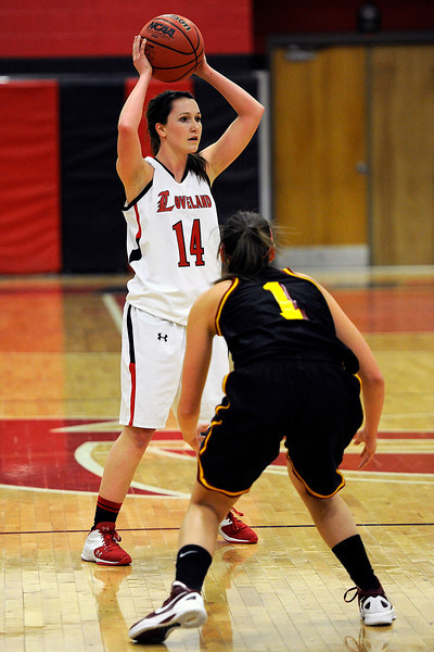 Loveland High School senior Kylie McCaffery looks for an open teammate to pass the ball to during a game against Rocky Mountain on Thursday, Feb. 9, 2012 at LHS.