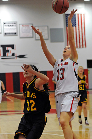 Loveland High School junior Brooke Nyenhuis, right, puts up a shot over Rocky Mountain's Wesley Bannister in the first quarter of their game Thursday, Feb. 9, 2012 at LHS.