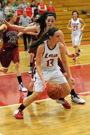 Loveland High School junior Brooke Nyenhuis, front, works in the low post against Chatfield's Emily Lachenmayer in the third quarter of their game on Wednesday, Feb. 22, 2012 at LHS.