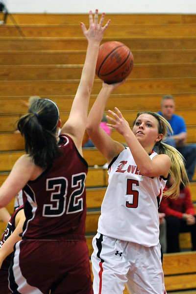 Loveland High School senior Bradey King, right, shoots over the outstretched hand of Chatfield defender Kristi Vaninger in the third quarter of their game on Wednesday, Feb. 22, 2012 at LHS.