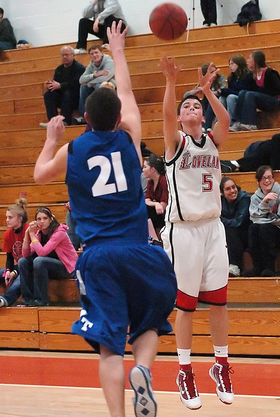 Loveland High School junior Cam Michael shoots a three-pointer over Thornton's Donald Boyer in the second quarter of their game on Friday, Jan. 29, 2010 at LHS. Loveland won 71-40.