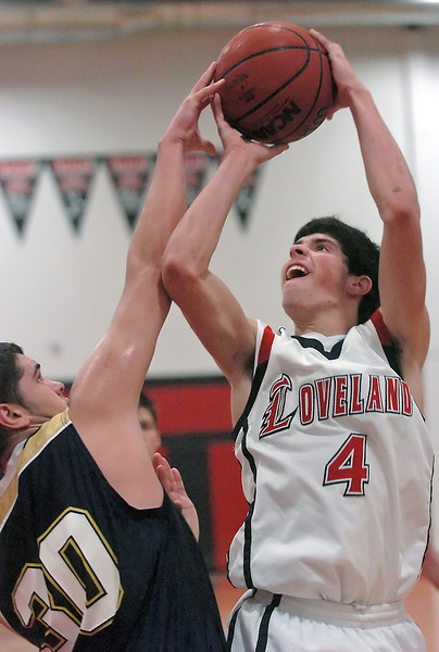 Loveland High School senior Michael Kielar takes a shot over Legacy defender Jade Roberts in the fourth quarter of their game on Tuesday, Jan. 12, 2010 at LHS. Loveland won, 67-43.
