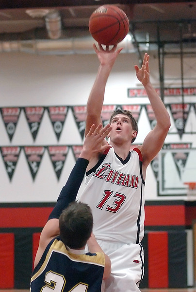 Loveland High School senior Kyle Klein shoots a jump shot in the lane over Legacy defender Brett Gioia in the third quarter of their game on Tuesday, Jan. 12, 2010 at LHS. Loveland won, 67-43.