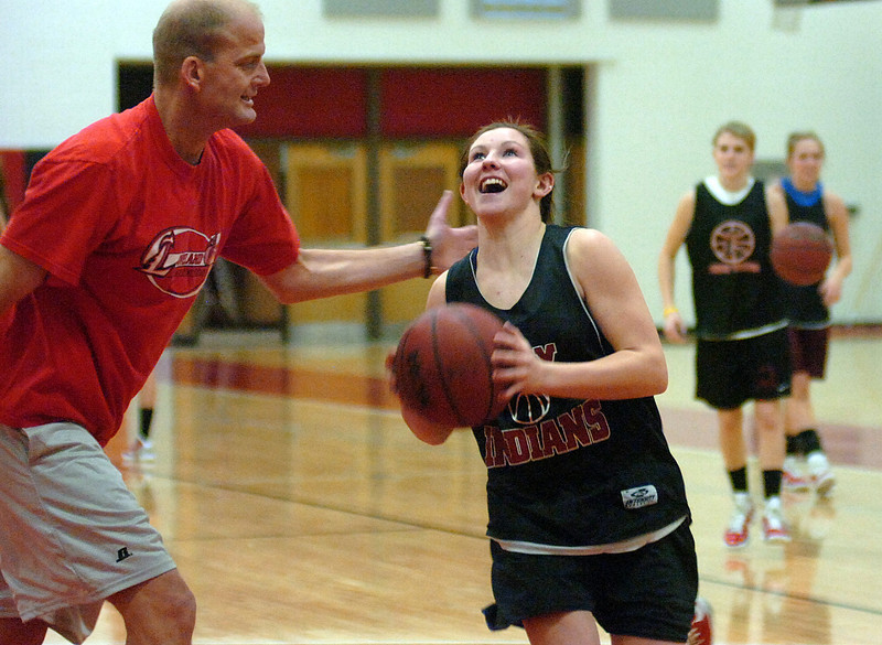 Loveland High's Colissa Bakovich tries to get past coach Chris Michael Monday night during a drill while practicing.