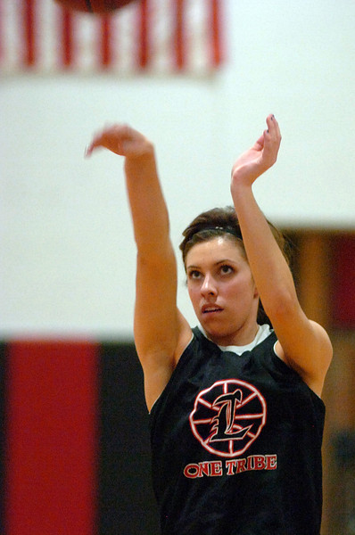 Loveland High's Michelle Petrie shoots the ball while performing a drill Monday night during practice.