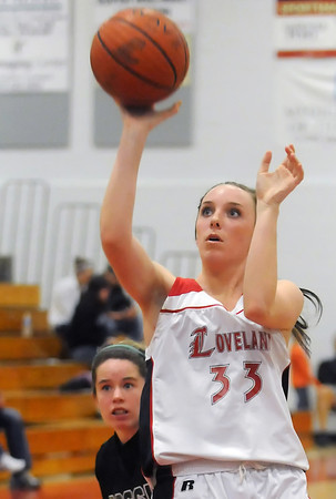 Loveland High School sophomore Brooke Nyenhuis takes a shot in front of Fossil Ridge's Haley Murphy in the third quarter of their game on Thursday, Jan. 13, 2011 at LHS. The Indians won, 51-33.