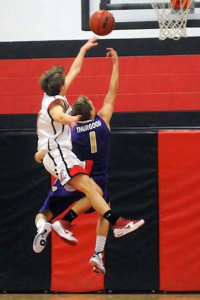 Loveland High School sophomore Brian Strasbaugh, left, attempts to block the shot of Fort Collins' Chase Thurgood during their game Jan. 7, 2011 at LHS.