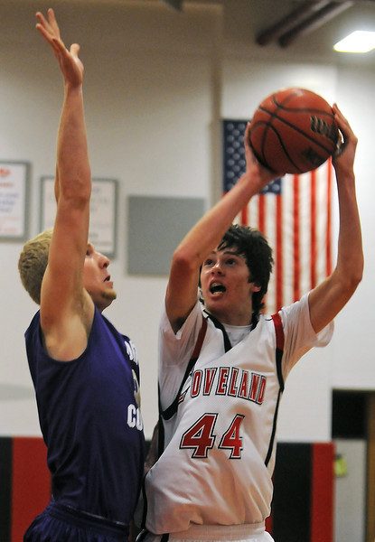Loveland High School sophomore Connor Lang takes a shot in front of Fort Collins defender Greg Svitavsky in the first quarter of their game Friday at LHS.