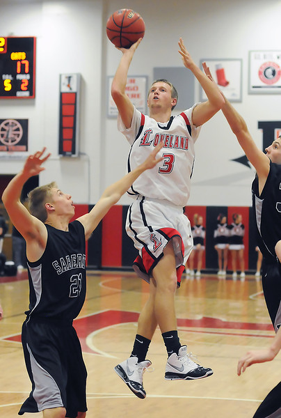 Loveland High School senior Taylor Svendsen (3) puts up a shot in the lane in front of Fossil Ridge's Brett Baeverstad, left, and Alex Blum in the second quarter of their game on Thursday, Jan. 13, 2011 at LHS. The Indians lost, 63-56.