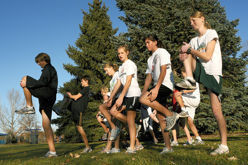 The Loveland High School Cross Country team warms up before a run at North Lake Park on Wednesday. The team's season would be done at this time if it wasn't for weather that caused the postponement of the state championships. Instead, the meet will be held this Saturday at Fossil Ridge High School in Fort Collins.
