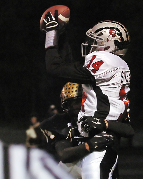 Loveland High School wide receiver Taylor Svendsen hauls in a touchdown pass in the end zone over Monarch defender Matthew Collins in the second overtime period of their Class 4A state quarterfinal game on Friday, Nov. 20, 2009 in Lafayette.