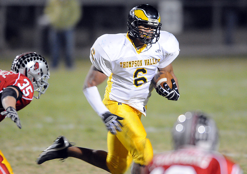 Thompson Valley's #6 Dorian Brown takes the ball down field past Loveland's #35 Dillon Lawrence.