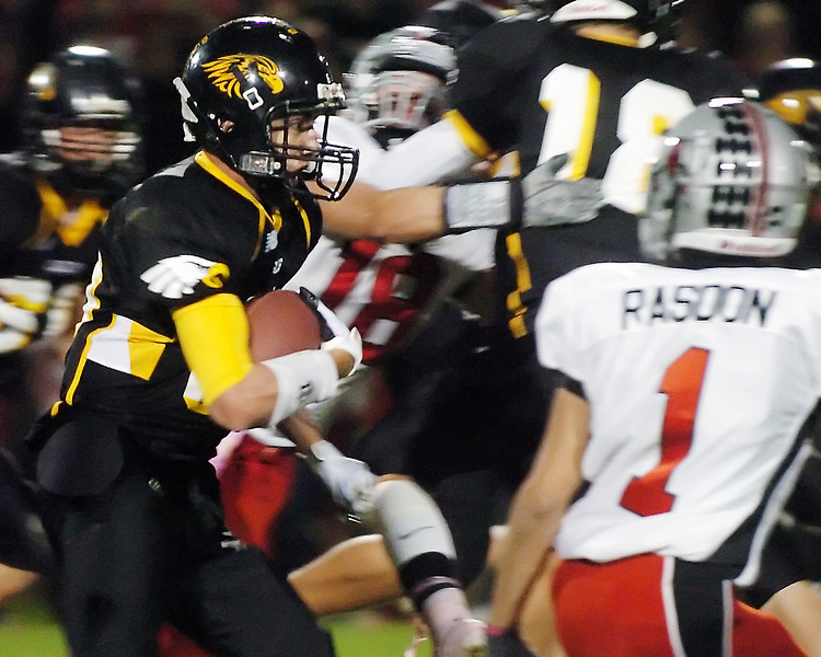 Thompson Valley High School's Turner McFadden makes a carry in the second quarter of a game against Loveland on Friday, Oct. 8, 2010 at Patterson Stadium.