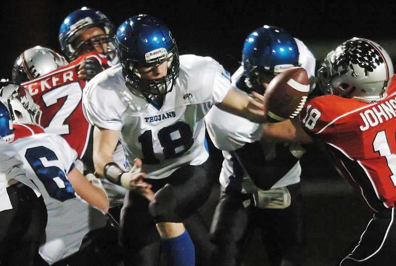 Longmont High School running back Mikal Merrill (18) fumbles the ball on a carry in the first quarter of a game against Loveland on Thursday, Oct. 28, 2010 at Patterson Stadium.