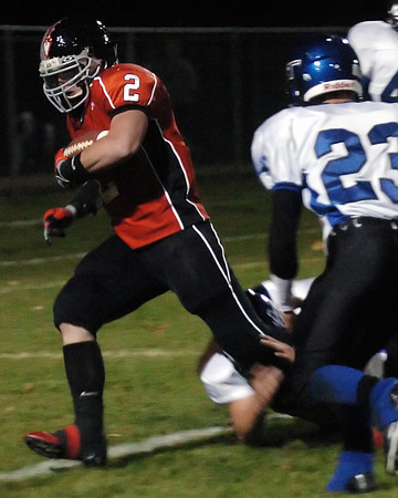 Loveland High School running back P.J. Case crosses the goal line for a touchdown in the second quarter of a game against Longmont on Thursday, Oct. 28, 2010 at Patterson Stadium.