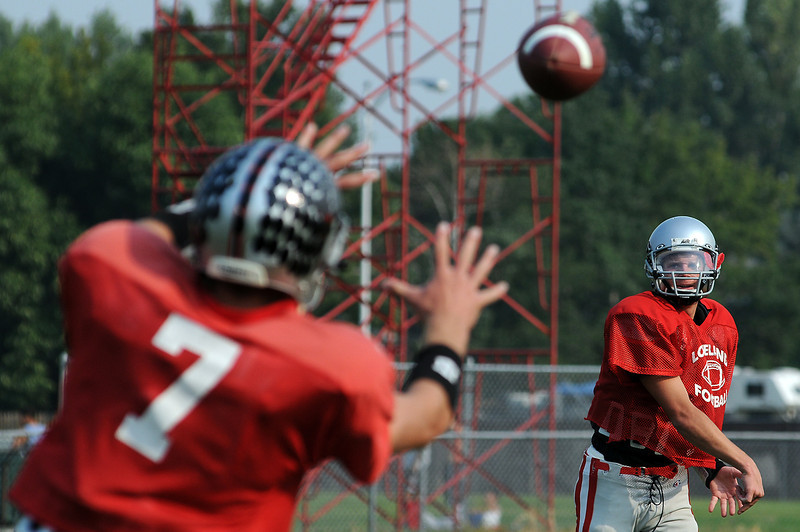 Scott Weissman tosses a ball to Kyle Klein on Tuesday during a practice drill at Loveland High School.