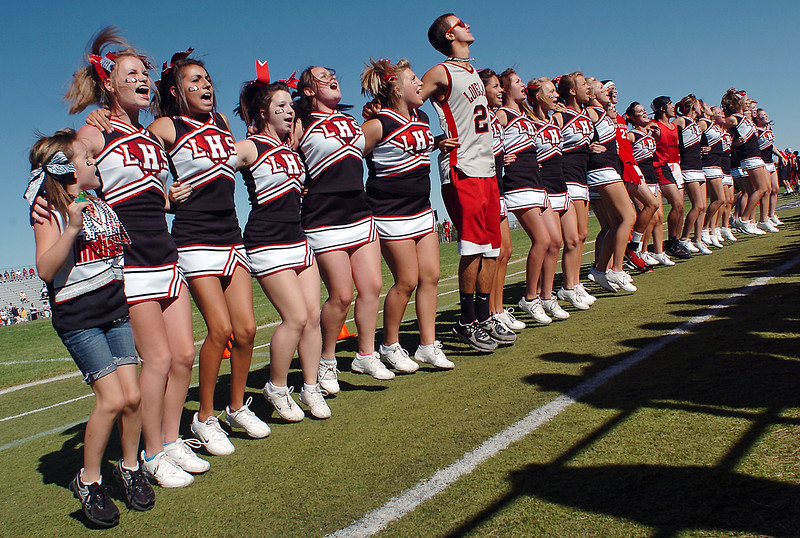 Loveland High School cheerleaders and fans cheer on the school's football team during a game Saturday afternoon at Patterson Stadium. Loveland beat Boulder High School, 13-7.