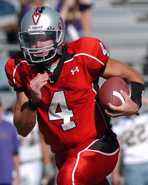 Loveland High School quarterback Scott Weissmann runs with the ball in the third quarter of a game against Boulder on Saturday, Sept. 11, 2010 at Patterson Field. The Indians won, 13-7.